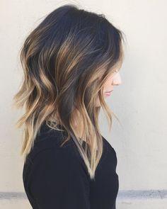 black layered hair with caramel balayage