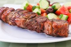 Souvlaki is so easy and perfect for summer grilling. This simple recipe marinates cubed pork chops in an oregano-laced vinaigrette.