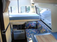 Compact windowed sprinter custom conversion. LOTS of pictures. Nifty partitioned shower idea that doesn't take up a lot of room.