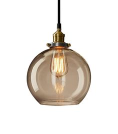 This Is How a Young Couple Decorates a Brooklyn Heights Warehouse Apartment via @MyDomaine | Restoration Hardware20th Century Factory Filament Clear Glass Café Pendant($149)