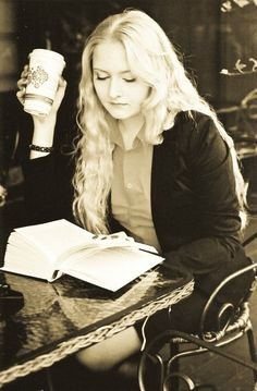 Coffee  Books. Blonde woman reading a book and drinking coffee.