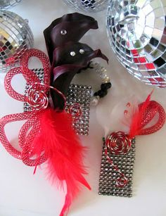 Black mini callas, diamond wrap, feathers and bling - prom wrist corsage and boutonniere.