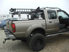 roof racks - posted in Beach Buggy Forum: I have a nissan titan pick/up truck, i want to put some sort of roof racks on it,, can`t find a manufacturer that makes them. Any info would be great. looking for surf racks! thanks mike Pick Up, New Gmc Truck, Navara Tuning, Monster Truck Room, 2004 Nissan Frontier, Nissan Hardbody, Navara D40, Truck Tailgate, Nissan Trucks