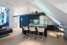 Futuristic Modern Kitchen Design Under Slanted Roof with Awesome Lighting on Kitchen Island