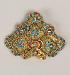 Nepal | Woman's brooch; gold, rubies, sapphires, emeralds and turquoise | ca. 17th - 19th century | British Museum Collection