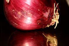 Red onion with reflection