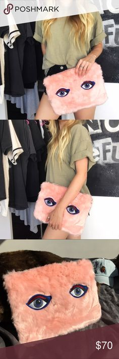 NWT Faux Fur Pink Clutch With Embroidered Eyes 👀 obsessed with this clutch!! it's so soft 😭❤️ Lined with detachable wristlet strap as well as full sized strap. Baby Pink. Lined. A very fun statement piece ✨ Unbranded.   ❣ ABSOLUTELY NO PP OR TRADES ❣ Nasty Gal Bags Clutches & Wristlets