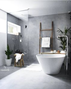I love the concrete style walls and flooring in this bathroom. A lovely shower corner and huge stand alone bath with plenty of rustic touches. Bathroom Design Inspiration, Modern Bathroom Design, Bathroom Interior Design, Interior Paint, Bathroom Renos, Small Bathroom, Bathroom Luxury, Bathroom Styling, Decoration