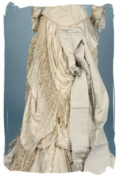 Antique lace gown with bustle.