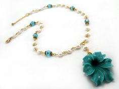 April Bloom necklace $27.00 - Ladies freshwater pearl necklace. Freshwater pearls, Swarovski crystal beads, resin flower pendant, and gold plated Tibet silver on gold plated wire.