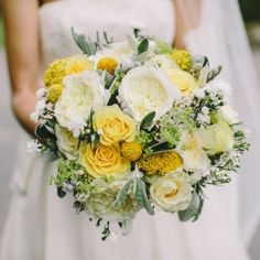 A yellow and grey themed wedding held in North Yorkshire complete with balloons, a Vera Wang bride and the sweetest pageboys.
