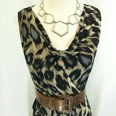 Beautiful animal print dress Beautiful animal print dress from Worthington size small. Gorgeous colors with a drape neck and easy fit. Polyester and spandex knit. Great dress for travel. Belt not included. 37 inches from shoulder to hem. Worthington Dresses
