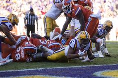 Nov 19, 2016; Baton Rouge, LA, USA; LSU Tigers running back Derrius Guice (5) is stopped short of the goal line on third down against the Florida Gators during the second half at Tiger Stadium. The Gators defeat the Tigers 16-10. Mandatory Credit: Jerome Miron-USA TODAY Sports