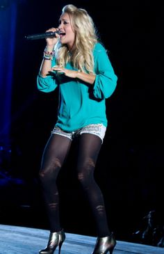Carrie Underwood storms the stage at the inaugural Boots and Hearts Festival at the Mosport International Raceway in Bowmanville, Ontario, on August 12, 2012.