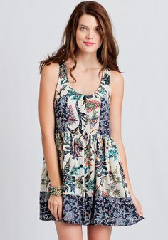 Perfect for a day spent outdoors, this stunning cream-colored dress features a multi-colored floral print.