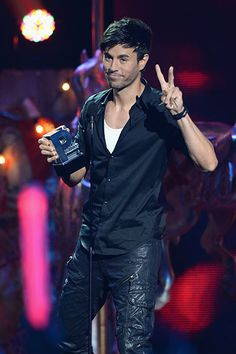 July 17: Enrique Iglesias accepts an award during the Premios Juventud 2014 at The BankUnited Center in Coral Gables, Florida.