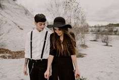 Black Wedding Dress for Wild Same-Sex Couple Wedding InspirationBride in Portez Vos Idées Black Wedding Dress Wedding Suits For Bride, Wedding Attire, Chic Wedding, Wedding Couples, Colored Wedding Dress, Black Wedding Dresses, Long Dress With Slit, Androgynous Women, Hair In The Wind