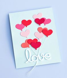 handmade Valentine card ... Penny Black Simplicity ... heart balloon die cuts in reds and pins ... floating in groups on sky blue card ... white strings ... die cut love ... great card!