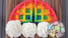 "Cute rainbow waffles with whipped cream clouds and a fun ""treasure"" at the end of the rainbow!"
