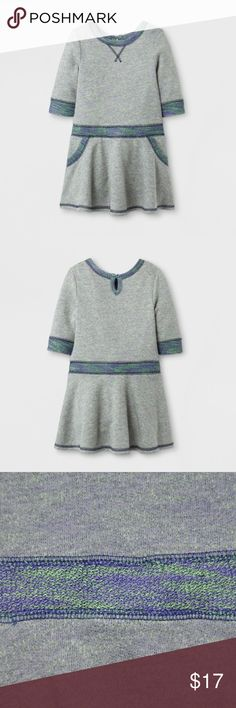 New CAT & JACK Marled French Terry A-Line Dress Comfort meets cute with the A-Line Dress from Cat & Jack. This sweatshirt-style dress keeps things fun with the contrasting trim, front pockets & flowy skirt. For an easy, casual day out, just dress her in leggings and sneakers, and she'll be ready to get things started.  available in size 2T   3T new without tags color: gray/purple  Soft, breathable cotton blend keeps her comfortable all day Midweight fabric is easy to transition between…