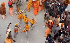 "Indian Naga Sadhus - holy men - of Shri Panchayati Anand Akhara participate in a religious procession as the first ""royal entry"" for the Kumbh Mela at Sangam in Allahabad on January 6, 2013. The Kumbh Mela, which is scheduled to take place in the northern Indian city in January and February 2013, is the world's largest gathering of people for a religious purpose and millions of people gather for this auspicious occasion."
