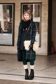 70 Looks From The Fashion Olympics #refinery29  http://www.refinery29.com/ny-fashion-week-street-style#slide36  We don't know what's more inspirational: Ashley Treece's baby bangs, her shag clutch, or that great use of layered socks.  ASOS Faux Fur Clutch Bag, $44.45, available at ASOS.