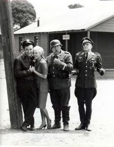 Colonel Hogan, Fraulein Helga, Sergeant Schultz, and Colonel Klink.
