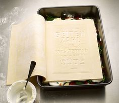 """The real and one and only cookbook"""" has indeed earned its title as readers can actually cook and eat it. Its artistically printed pages are made of fresh pasta for a classic lasagne."""