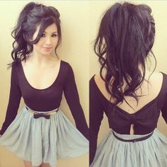 High ponytail, teased. I'm a fan of the outfit too: skirt, black bow belt, black scoop long-sleeve with peek-a-bow detail.