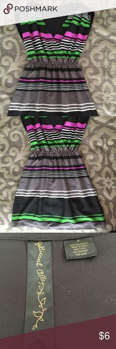 """Petticoat Alley minidress Riches shoulders and gathered waist, wrap-style bodice. 18"""" from waist to hem. 100% polyester. Could be used as either a minidress or tunic over leggings. Petticoat Alley Dresses Mini"""