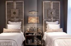 Love the color of the walls and these louvered bi-fold doors as headboards