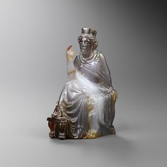 'Statuette of Tyche'. Roman, 1st century A.D. Material: Chalcedony, Dimensions: H: 12.0 cm. -Phoenix Ancient Art, Geneva & New York-