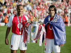 Thierry and Robert with the 2003-2004 throphy by Stuart MacFarlane