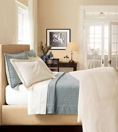 Another example of beige white and blue for a bedroom with dark furniture.