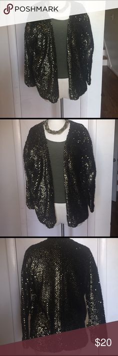 Express sequenced heavy cardigan-new without tags Super comfy and cozy cardigan. You could look glamours and be warm at the same time. It features pockets. Express Sweaters Cardigans