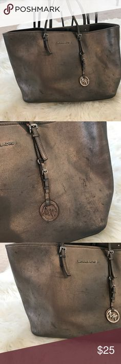 Metallic Michael kors tote Exterior has marks. Pictures show complete condition of bag. Make an offer. KORS Michael Kors Bags Totes