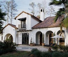 The red tile roof and wrought-iron accents lend a centuries-old authenticity to this Mediterranean-style home, but the crisp white stucco, stylized arches, and luxury amenities ensure the house isn't just a same-old rendition of a familiar historical look.