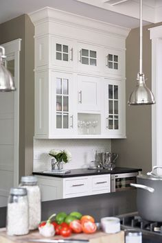 kitchen with khaki walls paint color, white kitchen cabinets, black granite  Need to fill the area between cabinets and ceiling like this cabinet!