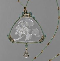"RENÉ LALIQUE. 1904-05 signed 'Lilacs' Pendant and Chain. Gold/ enamel/ engraved glass/ diamonds. Pendant is 2-1/4"" on a side. metmuseum.org"