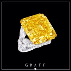This extraordinary one-of-a-kind Emerald Cut diamond ring showcases a 52.73ct Fancy Vivid Yellow diamond, complimented beautifully by white marquise and round diamond shoulders.