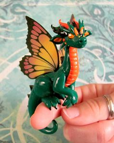 One of two butterfly dragons made on commission. I wasn't sure of the color choice at first, but with the right shades, he turned out beautifully! Green and Orange Butterfly Dragon Orange Butterfly, Butterfly Dragon, Baby Dragon, Pet Dragon, Water Dragon, Butterfly Wings, Fantasy Dragon, Dragon Art, Polymer Clay Projects