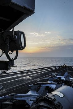 RED SEA (Sept. 7, 2013) – The sun rises on the aircraft carrier USS Nimitz (CVN 68). Nimitz Strike Group is deployed to the U.S. 5th Fleet area of responsibility conducting maritime security operations and theater security cooperation efforts. (U.S. Navy photo by Mass Communication Specialist Seaman Siobhana R. McEwen/Released)