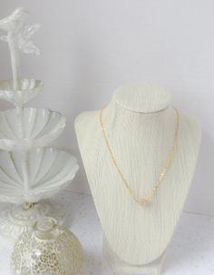 Gold Swirl Bead Necklace by InstinctBoutique on Etsy, $25.00