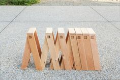 Torafu Architects - AA Stool. Horizontal stacking wood stools that can form longer benches.