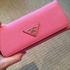 Pink Prada Wallet Pink Prada wallet. Used. Comes with protective bag, authenticity cards but not sure if it is actually a real one. Got as gift. Prada Bags Wallets