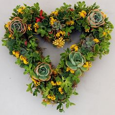 ~ Succulent Heart Wreath ~ Made w/ a wire wreath covered with moss....