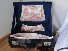 Navy blue vintage suitcase INSIDE handcrafted with red Toile de Jouy and dark blue padded fabric... €200,00, via Etsy.