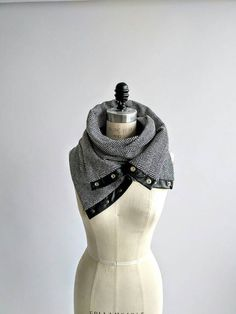 This season I created a collection of fun chunky scarf , practical and easy to wear, that will give an instant new look to any of your old coat . Not that It will become your best friend for the cold season , it will also be a timeless piece to your wardrobe. This one is a master piece , made of chunky herringbone black and gray pattern wool . Soft on the skin , this fabric is very warm and simply gorgeous . You can create different looks by playing with the structure of snap . I totally…