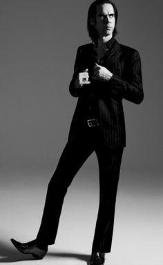Nick Cave...hot damn sir. I like that suit, he's always so debonair.