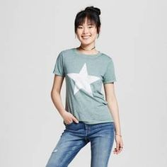 • Cotton/Polyester for comfy wear and easy care <br>• Large star graphic is fun and bold<br>• Classic crewneck cut is familiar<br><br>Play with stellar style in the Women's Distressed Star Graphic Tee in Green by Modern Lux (Juniors'). This women's star t-shirt has a fun look with one of your favorite pieces of clothing.<br><br>Used to Women's sizes? Size up in Junior's or check the size ...